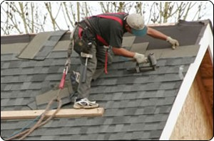 roffing employee working on a roof