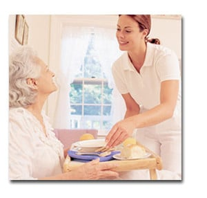 Caregiver assisting an elderly patient