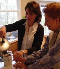 Home Health Care employee helping a patient in a kitchen