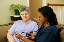 home health care aid with a patient