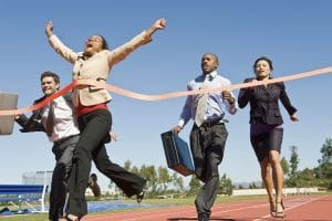 business people reaching the finish line